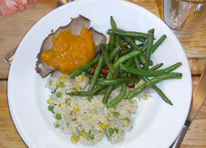 Photo of Slow roasted pork with apricot sauce, green beans and rice copyright 2004 Owen Linderholm
